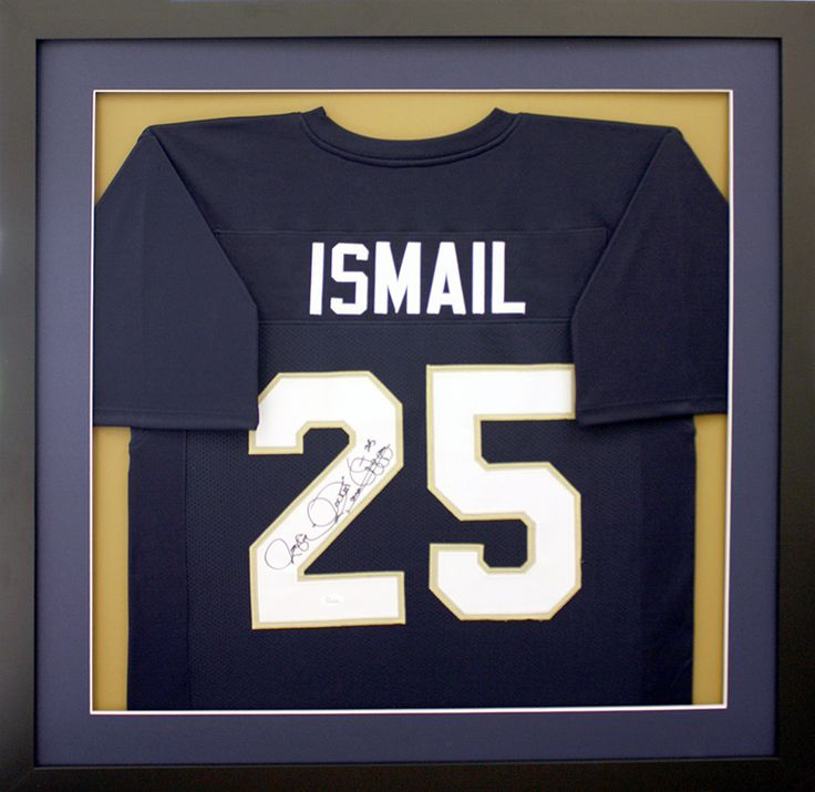 Ismail UND Football Jersey displayed in a black frame, with complementary gold background with blue and white mats. Designed and framed at Art & Frame Express in Edison, NJ. 732-777-0887 www.MyFramingStore.com
