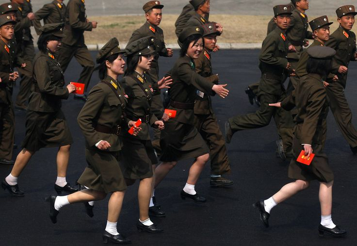 Soldiers run into a stadium to join a ceremony in Pyongyang, on April 14, 2012.