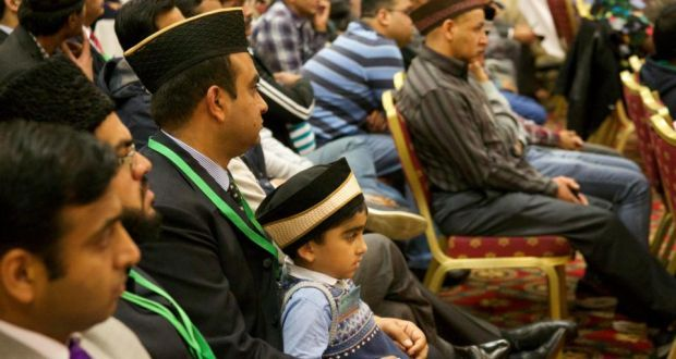 Mohammad Iftikhar (6) with his father, Dr Norman Iftikhar, at the 14th annual Jalsa Salana Annual Convention staged by the Ahmadiyya Muslim Association in Maynooth, Co Kildare. Photograph: Sara Freund/The Irish Times