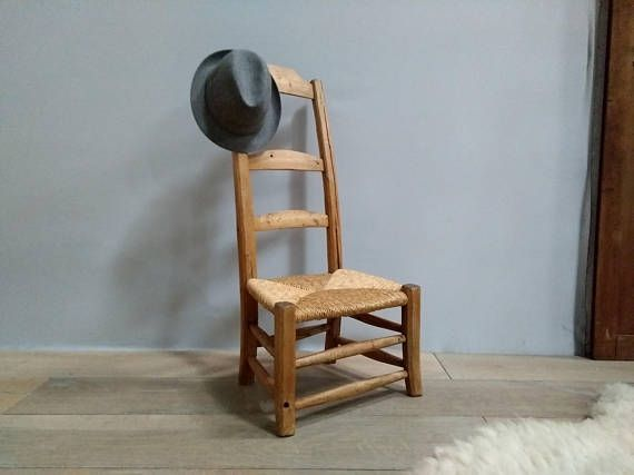 Entry room straw/wood valet Chair close old craft entrance fireplace ...