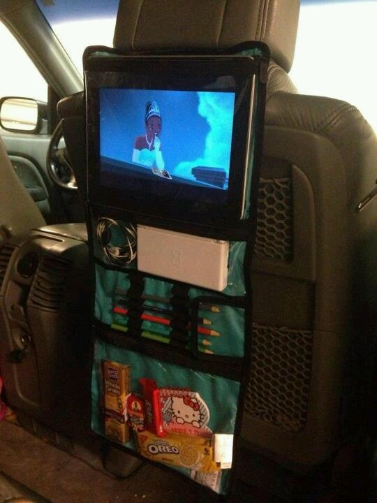 What an awesome idea for long trips with kids in the backseat...pop a movie on your iPad and poof...instant car theater!