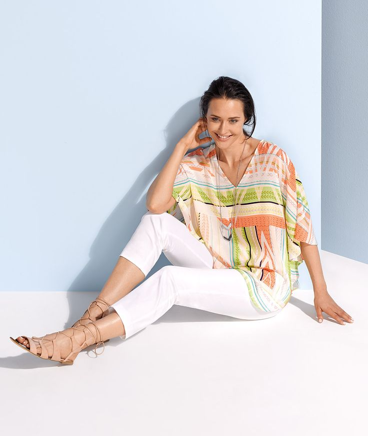 The kaftan top in a vibrant versatile print and easy wearing shape makes the styling options endless.