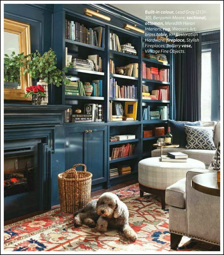 Stunning living room with built in library & fireplace.  Abby M. Interiors