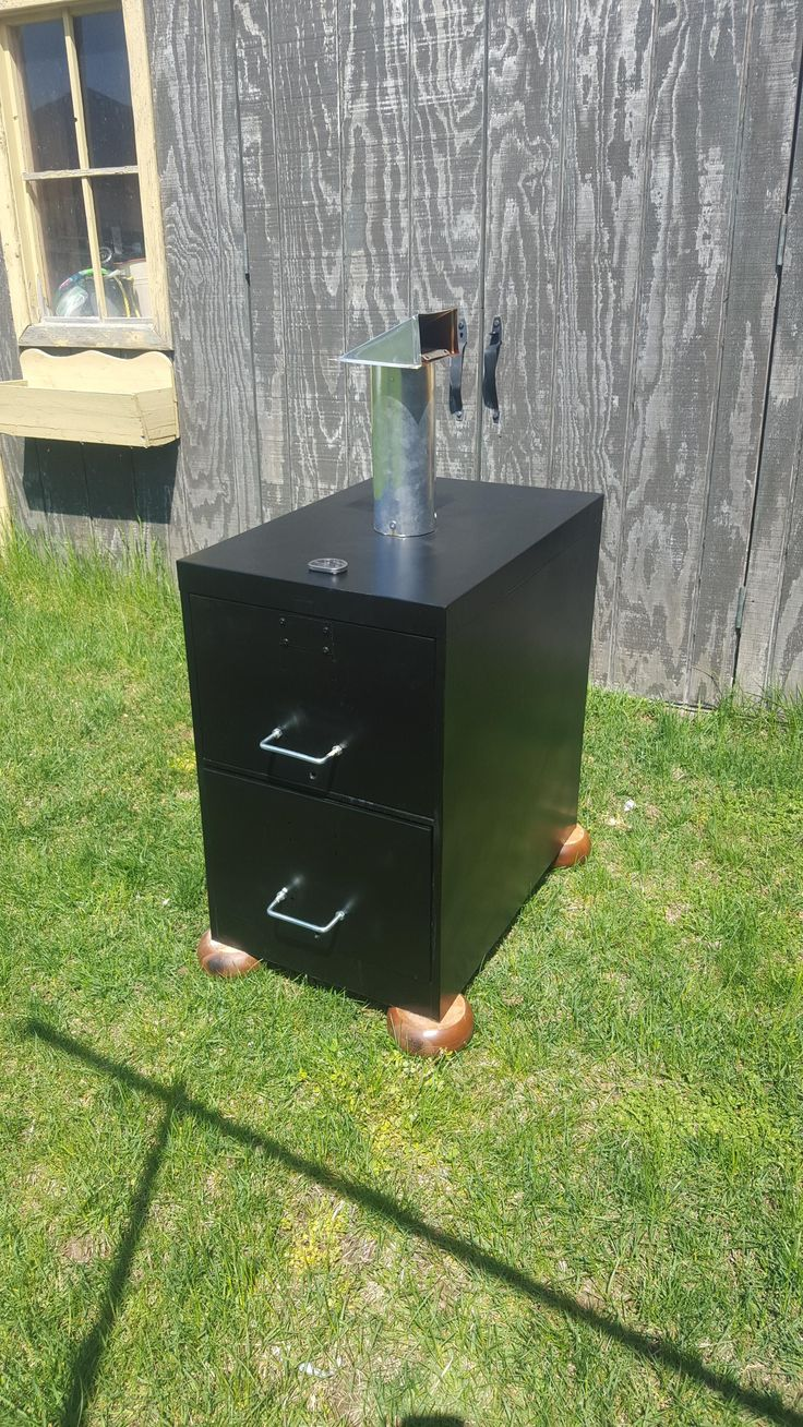 After seeing the redneck smoker post on Reddit a while ago my buddy and I were inspired to make our own filing cabinet smoker [OC]