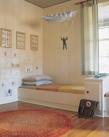 Whether you want to transform a whole room into a play area or decorate a bedroom just for little ones, these great ideas will help guide your decision to make it a fun-filled space.A paratrooper plummeting from the ceiling via fishing wire serves as the visual point of this kid-designed space. Framed U.S. Army posters decorate the walls and a single armylike bed is set against the wall.