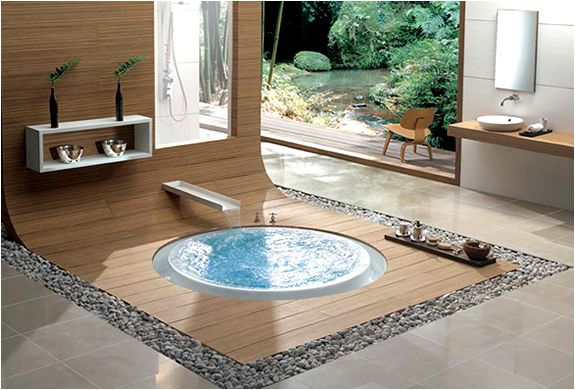 These bathtubs from Käsch, a German manufacturer, caught our attention, not just because they allow water to overflow like an infinity pool, but also due to their oh so aesthetically appealing flush with the floor finish. #bathtub #bathroom #pool #design #infinity #water #bath