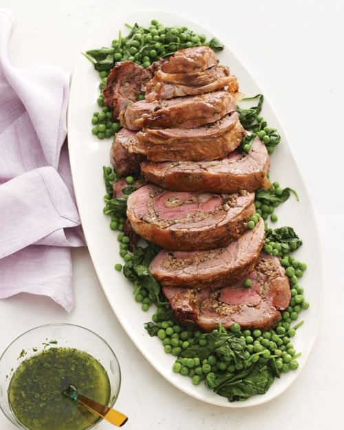 This sliced leg of lamb shows off spirals of artichoke stuffing -- Butterflied, Rolled, and Roasted Leg of Lamb Recipe