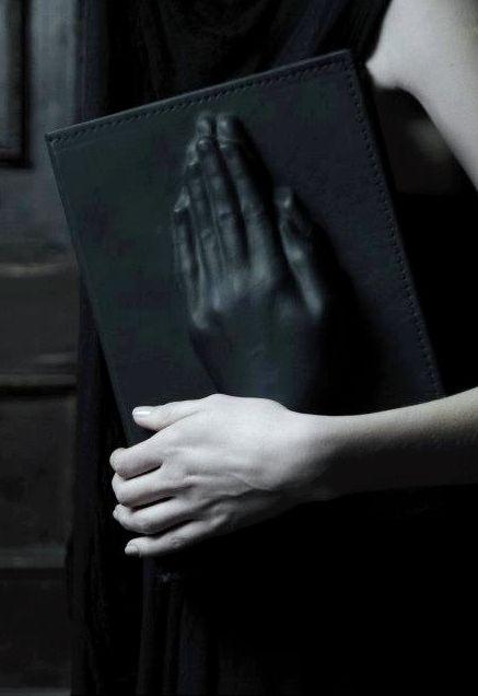 Leather clutch bag with praying hands impression; surreal fashion details // Konstantin Kofta