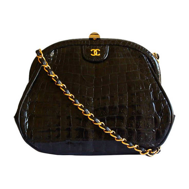 80's CHANEL black convertible crocodile bag with cross body strap | From a collection of rare vintage clutches at https://www.1stdibs.com/fashion/handbags-purses-bags/clutches/