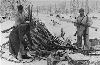 Finnish soldiers sorting through Russian supplies and gear left behind after the Second Battle of Suomussalami during the Russo-Finnish War. Pin by Paolo Marzioli
