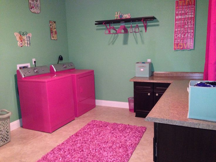 Pink and green laundry room with hot pink washer and dryer!