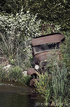 Need a Tow? Abandoned Vehicle by Holly Kuchera, via Dreamstime