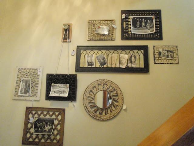 I always love what they do with the stairwell and this time I was even more amazed!  Here they used assorted salvaged grates as wall decor and photo holders.  I see grates all the time at salvage stores!  Now that I've been given a little inspiration, I need to get some! They also have an old doorknob used to hold one of the grates.