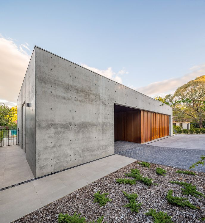 Corten And Concrete. Extreme Massive Concrete House With Garage.