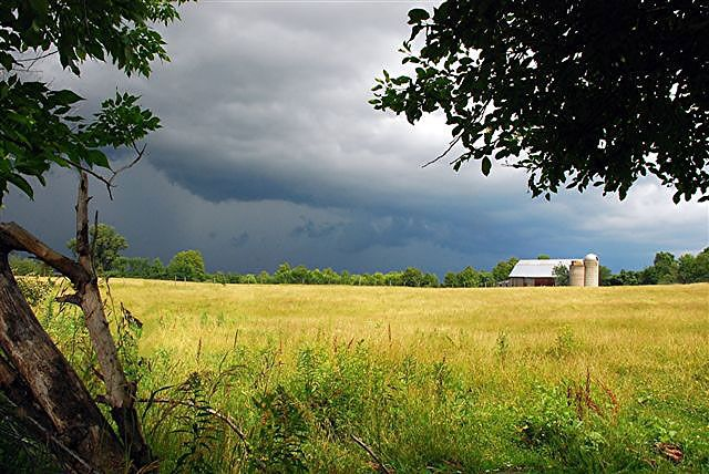 summer storm over farm