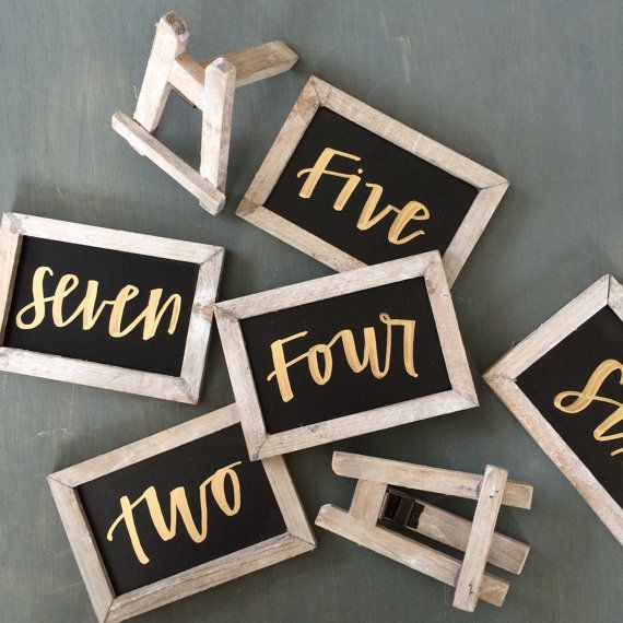 These mini chalkboards will be the perfect addition to your tablescape! Chalkboards can stand vertically or horizontally and sit on adorable mini easels (detached but included with purchase). Chalkboards will come standard with table numbers written out horizontally. If youd prefer a numerical number standing vertically, please include that in the notes. These come handlettered by me in either gold or white (please specify your choice in the notes at checkout). Color Options: Worn White…