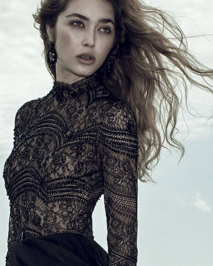 Black french lace three quarter sleeve evening dress embellished with black Swarosvki pearl.