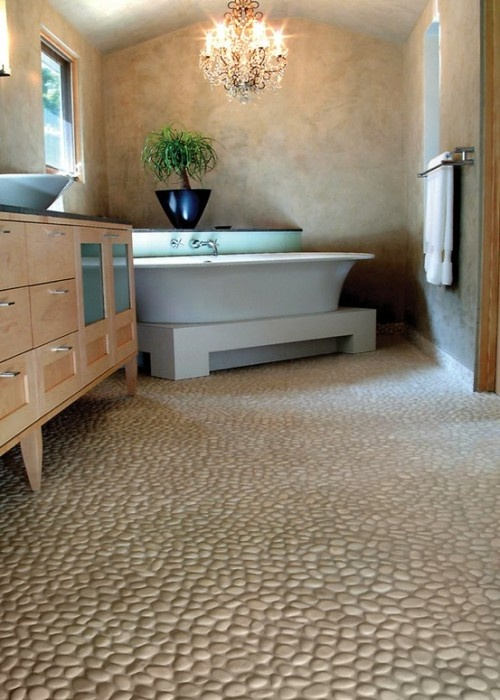 lovely serene bathroom tub placement is fantastic as is real river rock floor