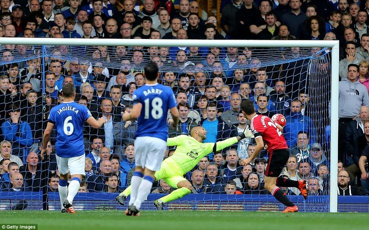 Goalkeeper Howard is unable to claw Herrera's close-range effort to safety as Everton's troubles doubled in the first-half at Goodison