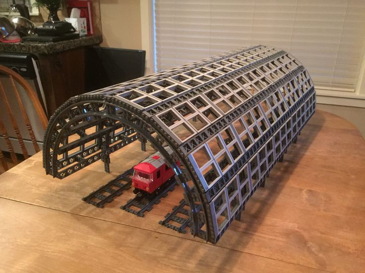 https://flic.kr/p/AVkfsd | Train station platform canopy. | Copying some great work I saw on Flickr I'm using train track to create the half circle arch. But I'm using the narrow gauge train track for a smaller canopy. Also incorporating altBricks girder elements. This gives it the cast-iron look of that era.