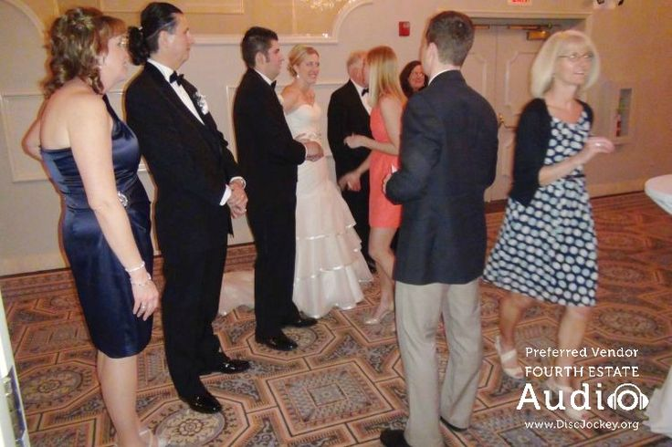 Newlyweds Kate and Rich greet their guests at Drury Lane. #RealChicagoWedding