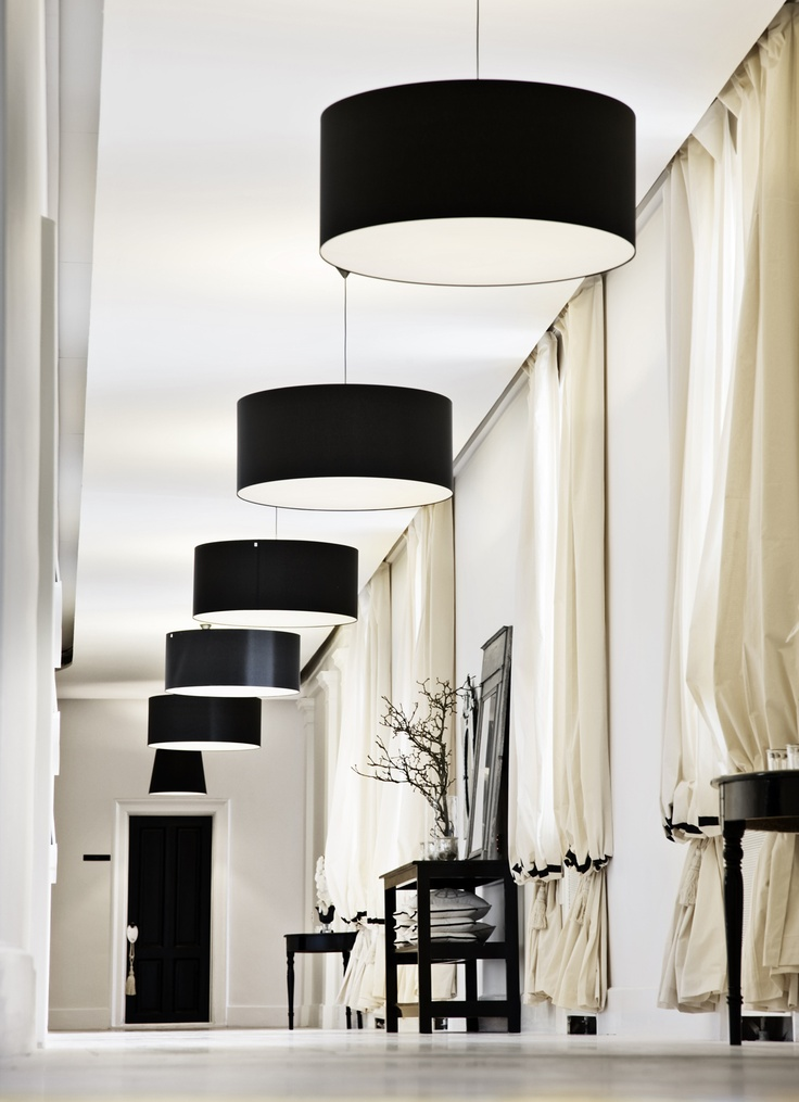 Simple eloquent hallway light. Hang at slightly different lengths to give the appearance of more length in hall? Shortest light closest to kitchen