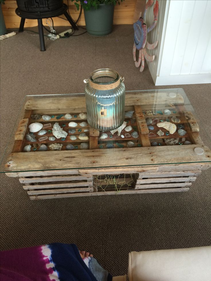 Lobster/crab trap table. Trap, shells and sea glass came from Myrtle Beach, SC. Hurricane and candle from Pier 1.