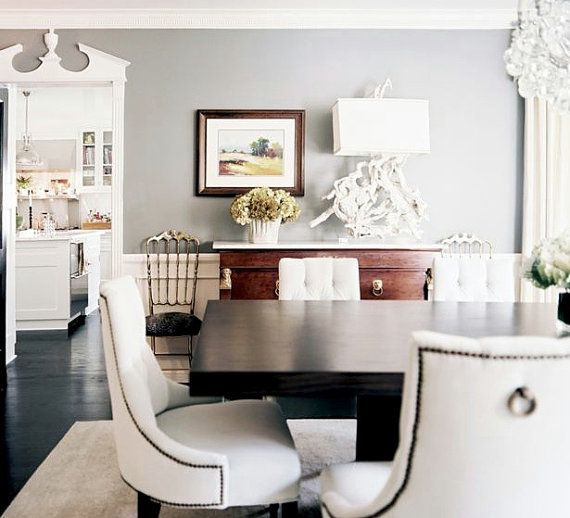 What I like about this room... molding, black floors, dining chairs, driftwood lamp