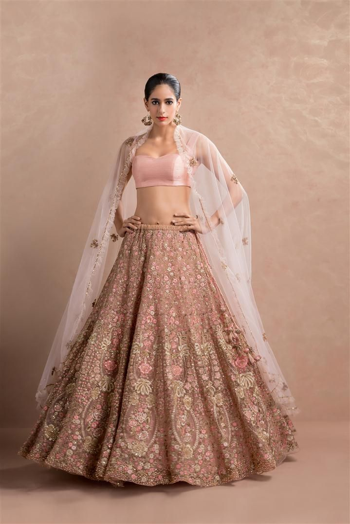 Maybe this style in the red embroidered lehenga; use if teo colors in the embroidery self and another one|■ SHYAMAL & BHUMIKA