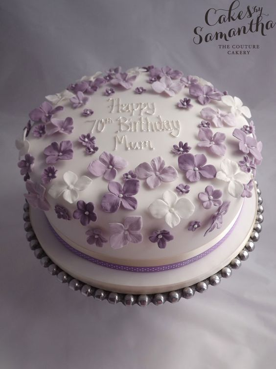 70th Birthday cake with purple flowers.