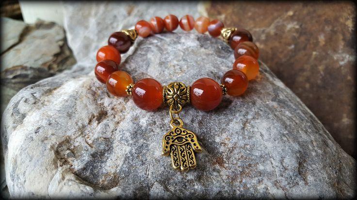 Stretch gemstone bracelet made with Sardonyx stones and vintage gold Hamsa hand charm. Boho Style Yoga Jewellery Gift For Her Bohemian