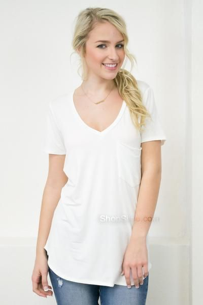 This basic slouchy top is a necessity for every woman's wardrobe. This soft top features a front pocket, deep v-neck, short sleeves, and flowy body. I love how you can layer ANYTHING over this plain t