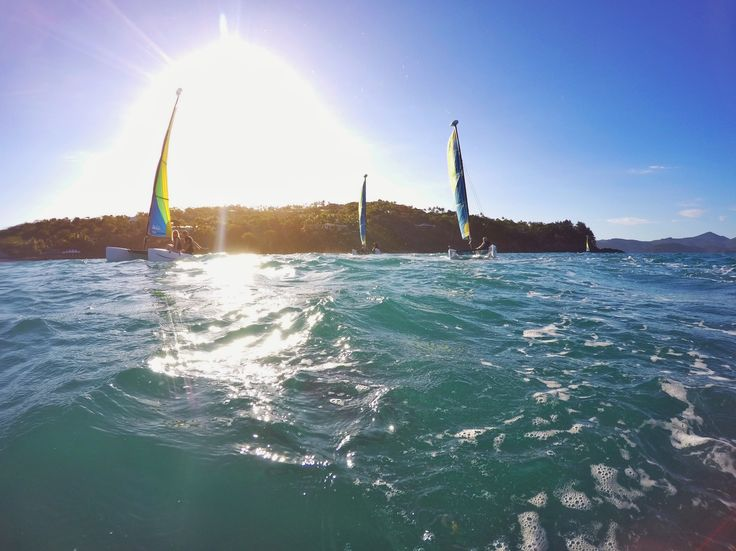 Sailing through the #Whitsundays ... absolute #bliss. If you're on #HamiltonIsland, these catamarans are waiting for you to hire on #CatseyeBeach.