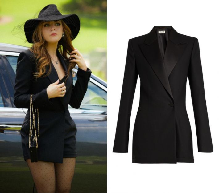 "Fallon Carrington (Elizabeth Gillies) wears this black satin trimmed long sleeved blazer romper in this episode of Dynasty, ""Spit It Out"" It is the Saint Laurent wool black romper."