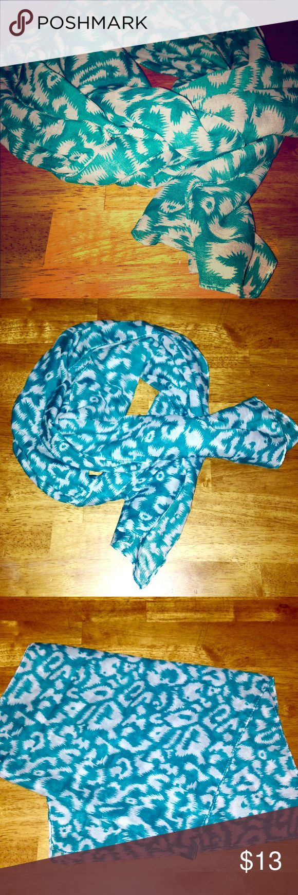 NWOT • Women's Turquoise & White Leopard Scarf 🐆 NWOT • Women's Turquoise & White Leopard Scarf 🐆 Very Light & Airy scarf, great to dress up any outfit. Nice for a Spring or Summer day!! ☀️ Accessories Scarves & Wraps