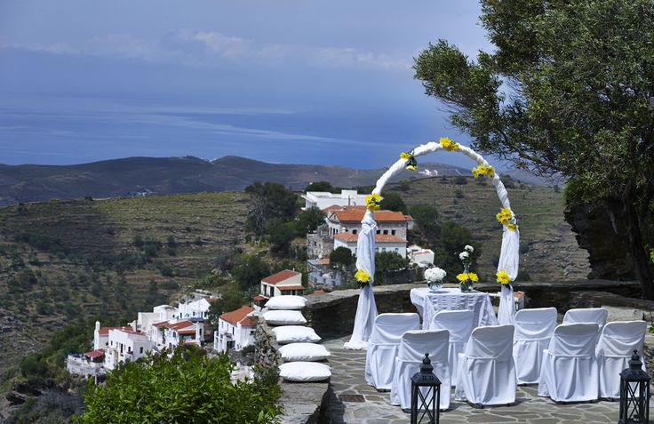 A whole wedding party embraced by the Aegean Sea.