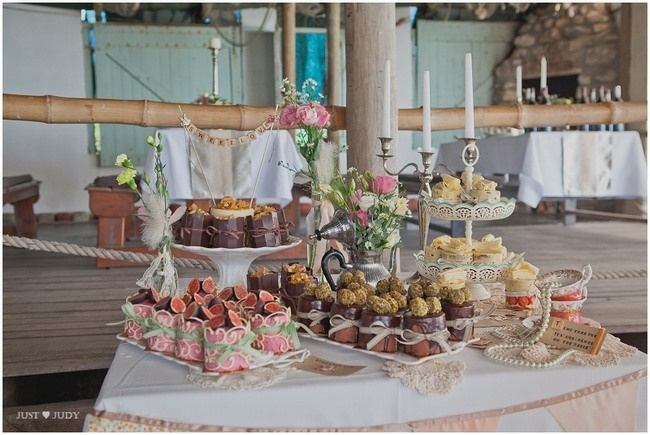 Handmade Rustic Beach Wedding {Strandkombuis Beach} | Confetti Daydreams - Dessert table decorated with miniature cakes, pink bunting, lace doilies, ticket-style food tags and pearls ♥ #BeachWedding #CapeTown #RusticWedding #RealBride