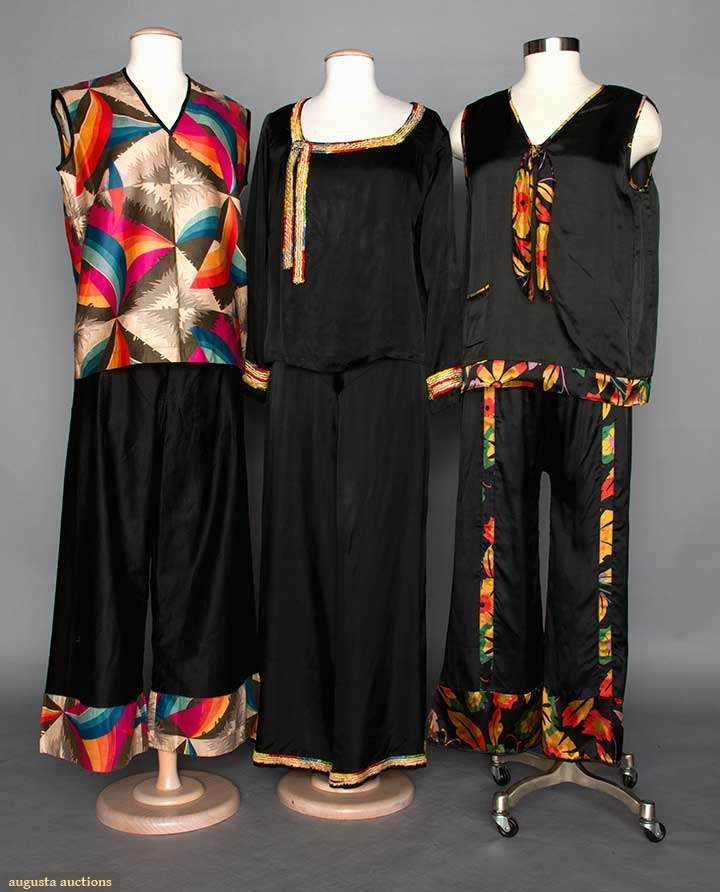 3 Ladies Pajama Sets, 1920s. 2 3-piece w/ wide-leg pants, sleeveless tops & matching jackets: 1 black rayon w/ floral print in bright colors; 1 black cotton w/ colorful abstract print trim; 1 2-piece black satin w/ embroidered trim; t/w 1 black silk top w/ colorful tambor embroidery.