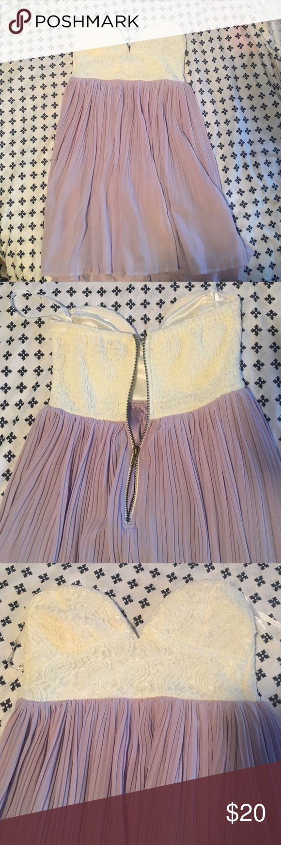 Lavender strapless dress *READ DESCRIPTION* This dress is absolutely gorgeous!! White lace top with a lavender tulle bottom. This has only been worn to try on. BUT the zipper is broken! The zipper doesn't come together as you zip it, see picture. Please take that into consideration when purchasing. Would suggest purchasing if you know how to fix the zipper, I've tried! However if you get the zipper fixed, it is an absolutely gorgeous dress in perfect condition - just been hanging in my…