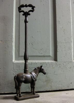I love this doorstop! Try to find Uncles silver horse in storage boxes to make a similar one welding on a handle, then get out the spray paint!