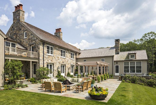 Farmhouse Patio The rear terrace is the focus of the family's outdoor living and includes a pergola, outdoor kitchen and fire pit #Farmhouse #patio #Terrace Haver & Skolnick LLC Architects