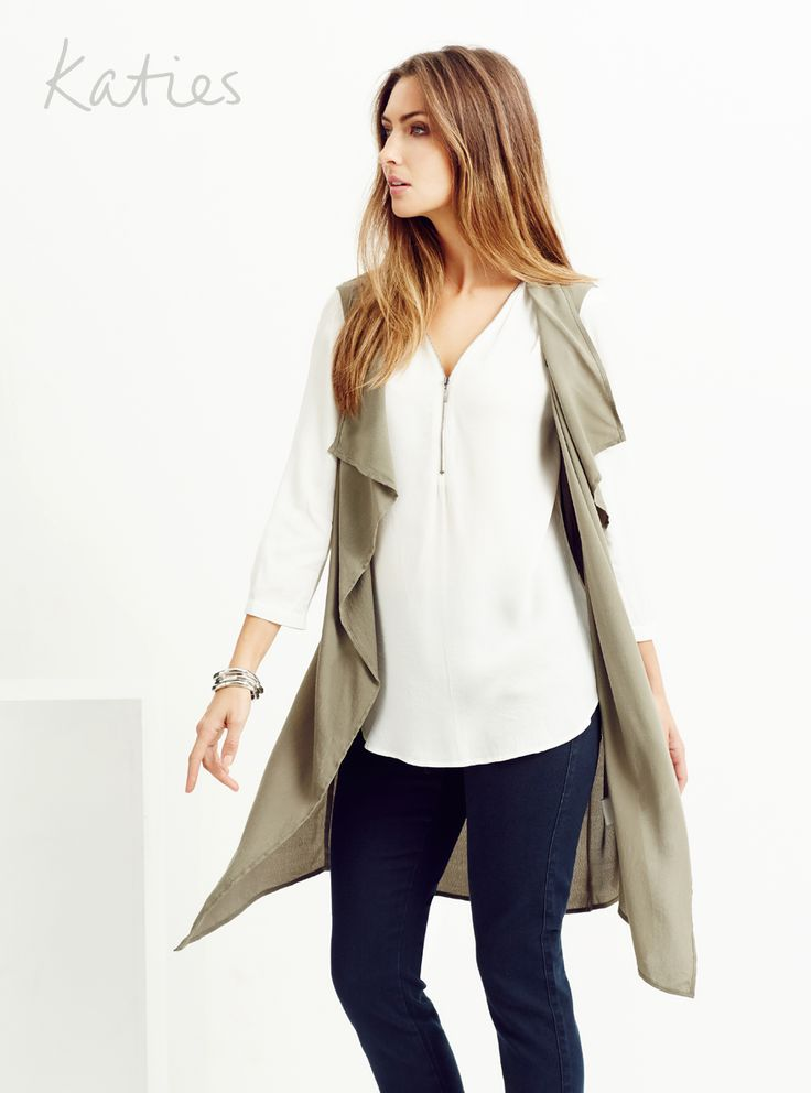 SLEEVELESS BELTED TRENCH / The must-have soft trench goes sleeveless for the ultimate multi-tasking piece. Look new season now by layering over a blouse or under a jacket and take your look from simple to stand-out.