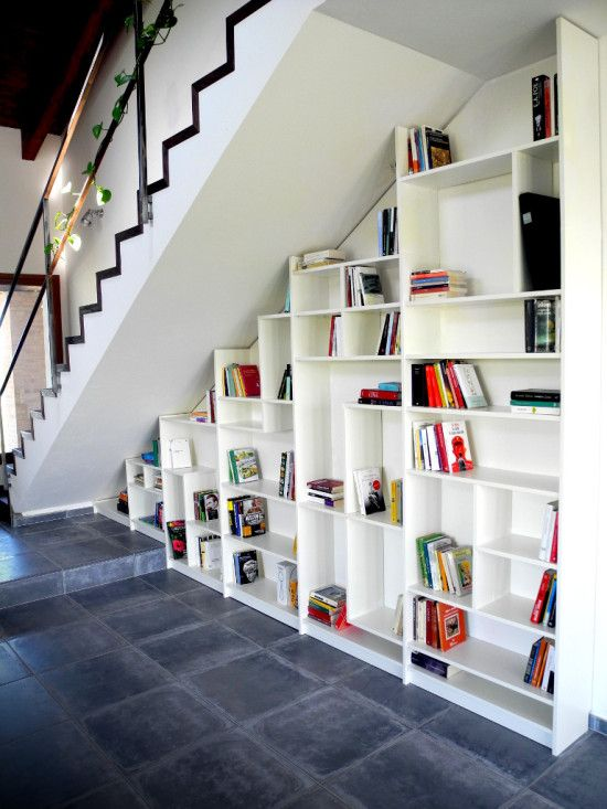 Billy bookshelves hacked to fit under stairs with modified shelves | Fabiano Taioli & Simone Antonelli on IKEA Hackers