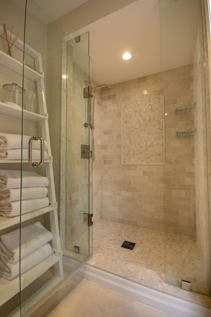 #AvalonInteriors: Ensuite shower with glassed in enclosure, crema marfil wall & floor tile