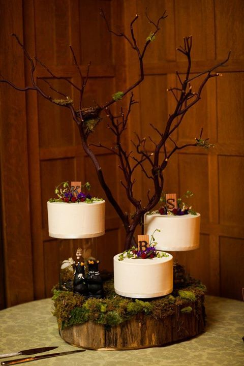 Incredible tree round cake stand for a woodsy trio of wedding cakes on a Meadowood Fern linen from Napa Valley Linens