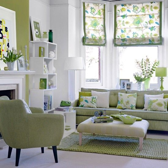 green living room design:  good example of Chromatic Distribution, with largest areas in neutral white, and smaller accents in bold green.