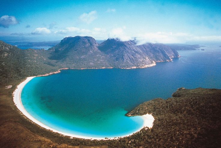 Remote and utterly unspoilt, Tasmania is a land of rugged mountains, shimmering lakes and old-growth forests. It's the spectacular juxtaposition to its most luxurious accommodation – Saffire Freycinet. #luxury #travel #getaway