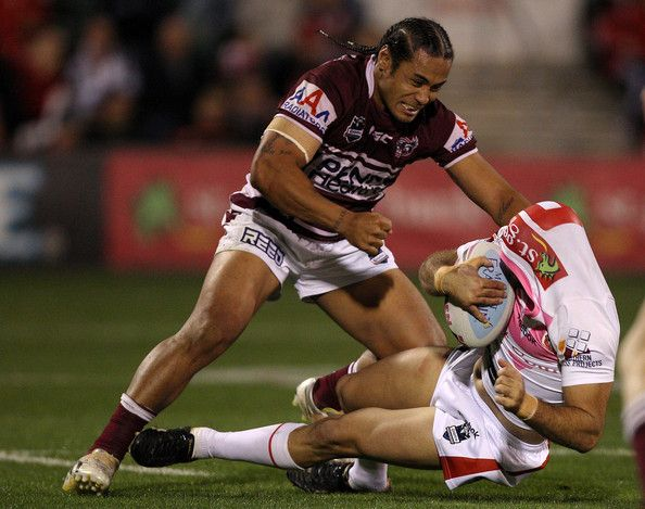 Steve Matai Photos - Steve Matai of the Eagles hits Jason Nightingale of the Dragons in a tackle during the round 16 NRL match between the St George Illawarra Dragons and the Manly Warringah Sea Eagles at WIN Stadium on June 27, 2011 in Wollongong, Australia. - NRL Rd 16 - Dragons v Sea Eagles