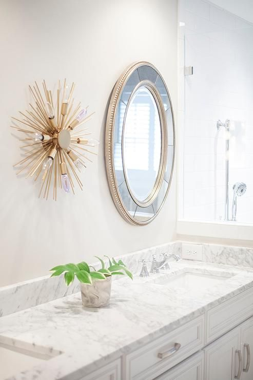 Amazing Master Bathroom Features A White Dual Washstand Topped With Carrera Marble Fitted His And Hers Sink Under Round Beaded Mirror Illuminated By