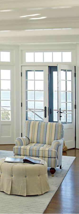Similar idea with paneling at bottom of doors matching flanking windows...this could work.   --KG   Beach,Coastal living,Seaside home decor,
